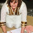 Cherie Blair QC adds her signature to the live painting