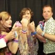 Scissor Sisters pose with Whatever It Takes charity wristbands decorated with their artworks